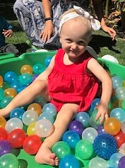 Baby Zoe playing in ball pit
