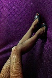 Woman wearing compressing stockings.