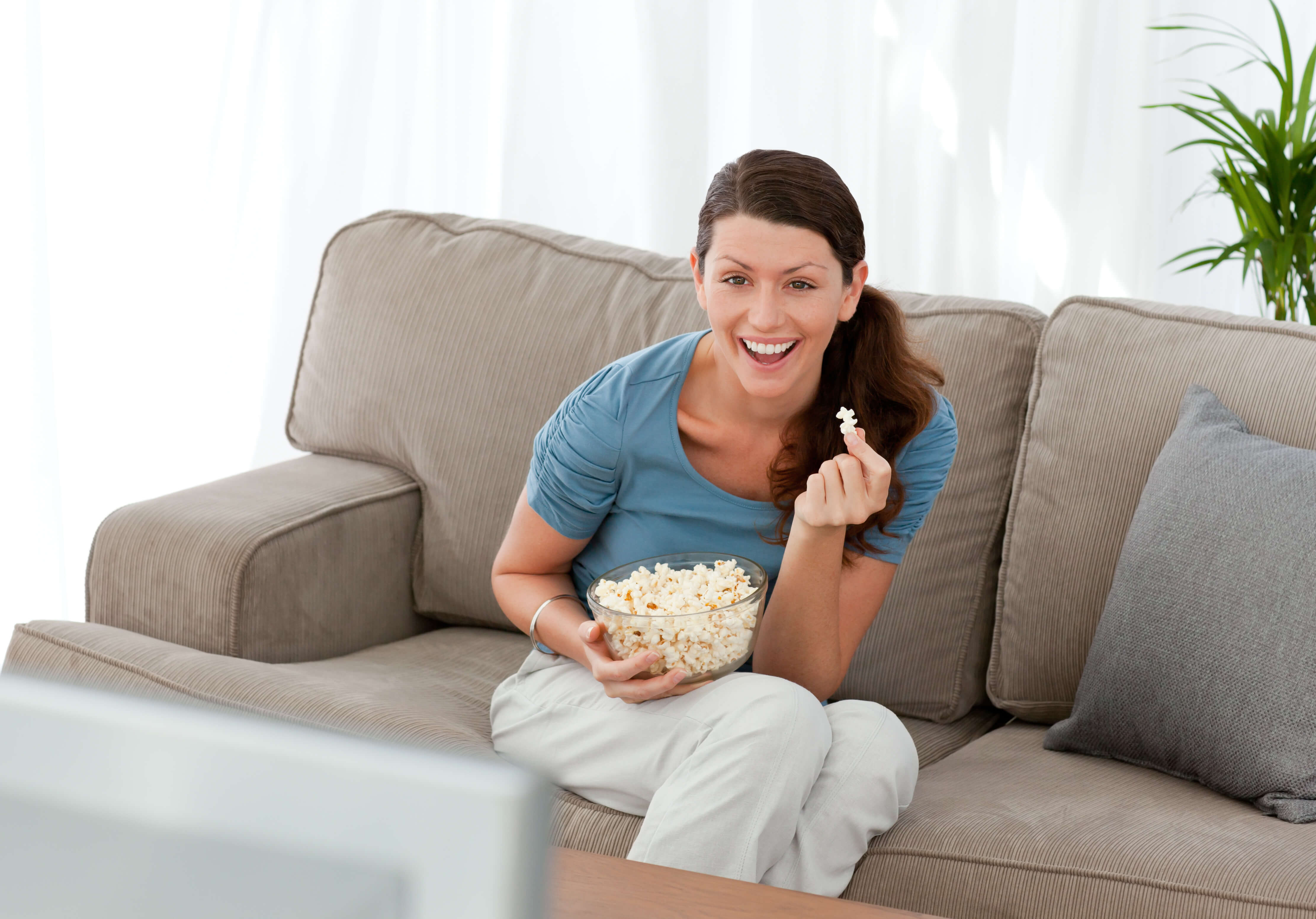 Woman watching a funny movie and laughing