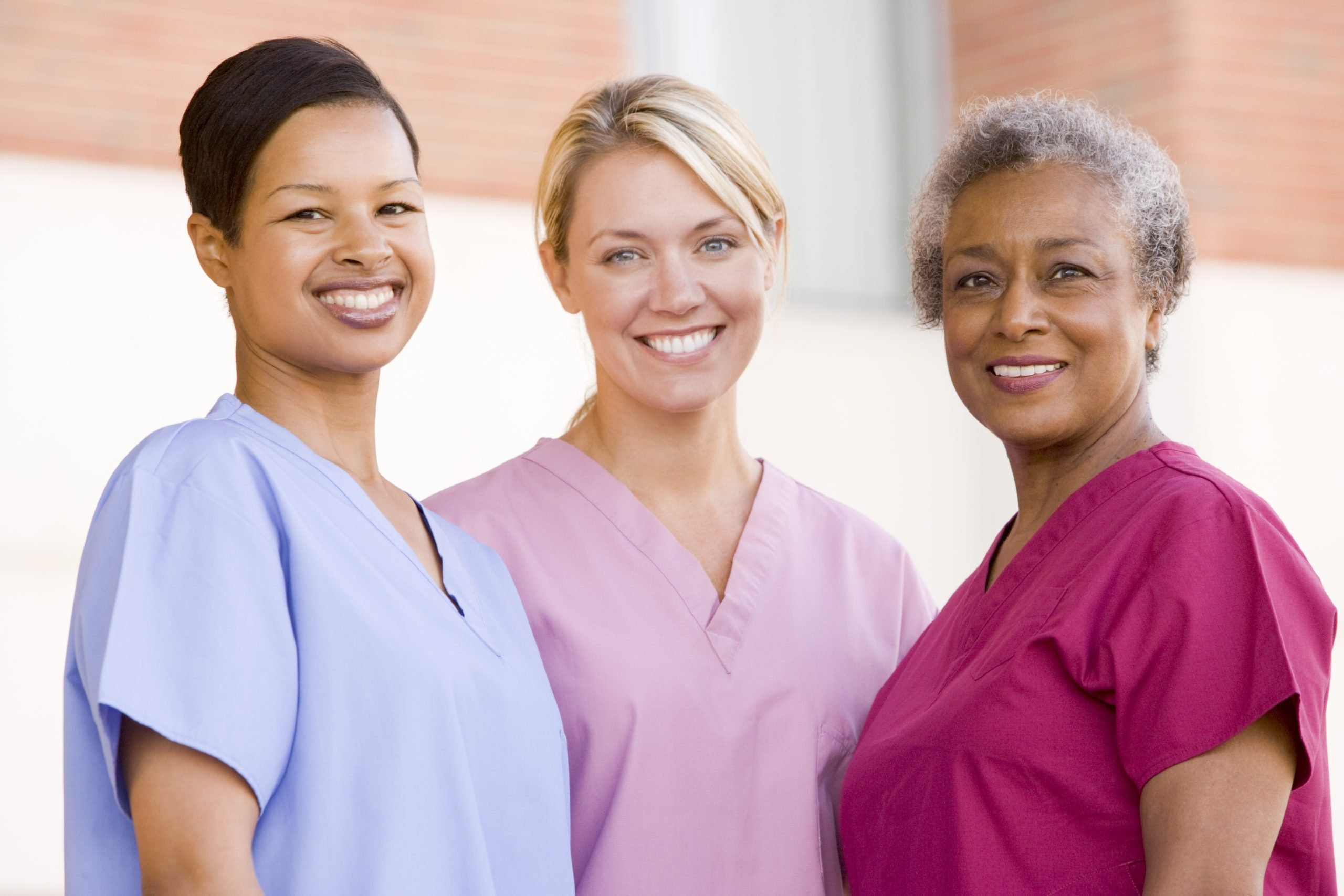 three female nurses of different cultural backgrounds